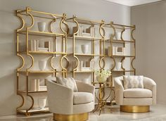 These gold bookshelves and swivels are two of favorite things! Beauty and sophistication.