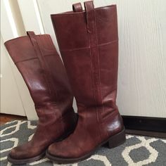 Tall riding boots Lucky Brand riding boots with pull tabs and elastic section at the top of each boot. These boots are so comfy and gently used. Few scuffs at front but still in beautiful condition. Color is cognac- beautiful color! Goes with any thing. Also comes with original box! Lucky Brand Shoes Heeled Boots