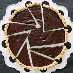 Diana Henry says her bittersweet chocolate tart (in tomorrow's mag) is best in thin slices. We beg to differ.