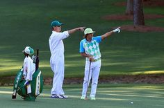 April 12: Rickie Fowler and caddie Joseph Skovron lined up his second shot on the par-5 13th hole.