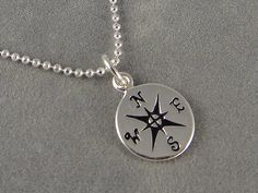Hey, I found this really awesome Etsy listing at http://www.etsy.com/listing/152095980/tiny-sterling-compass-necklace-nautical