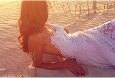 Breathtaking beach lace wedding dress with stunning low back and floaty skirt