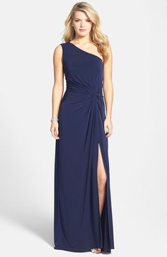 Free shipping and returns on Laundry by Shelli Segal Front Twist Jersey One-Shoulder Gown at Nordstrom.com. A single elegant strap wraps over one shoulder and twists at the cutout back of a svelte jersey-knit gown. A front knot emphasizes the slender silhouette in the most flattering way, and a deep side slit ensures that there's room to move.