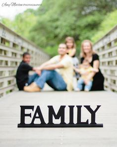 Great FAMILY PHOTO idea! I like the casual pose... Not so much the foreground / background focus and word block.