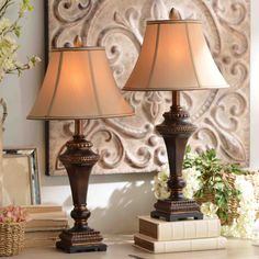 The set is perfect for accenting a set of nightstands in your bedroom or adding the final touch to a living space in need of some light. With gold highlights and a tan shade, the pair transitions perfectly into any color-themed room in your home.