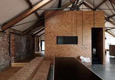 The Ochre Barn in Norfolk is a multi-purpose development which houses a retreat, studio space, and residential accommodation. Carl Turner Architects, who designed and completed the project, kept all the original brickwork and worked with existing openings when adding the sliding doors.    ph. Damian Russell