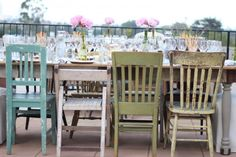 colorful, shabby chairs - i love that they don't match!  would be perfect with the table my dad is making me....can't wait.