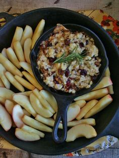 CRANBERRY BRIE DIP -  2 8 oz packages of brie cut into small pieces (Don't bother using the expensive stuff for this dish), 1/3 C dried cranberries, 1/4 C chopped candied pecans (If you can't find candied pecans, just use regular ones), 1 tsp fresh rosemary (chopped)