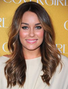 Looking for a sexier V-Day hairstyle? Try hot, beach-worthy waves like Lauren Conrad's. The key to getting this seductive hairstyle is to make sure you wrap hair loosely around a large curling iron to avoid tightly coiled curls. Run fingers through your hair to break up the pieces and muss up the ends for a sultry look.