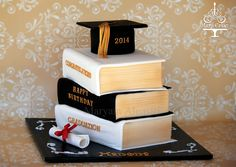 Graduation cake , stacked book cake  By : Mary Cakes