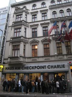 """Checkpoint Charlie. Established in 1962 next to the legendary Checkpoint Charlie border crossing, the """"Haus am Checkpoint Charlie"""" Museum is an exhibition on the history of the Berlin Wall and the partition of the city. It contains original items used in underground, overground and even airborne attempts to flee East Germany. There are also exhibitions on Berlin's history and on the international non-violent fight for human rights."""