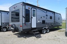 """SLEEK, LOVELY RV INSIDE AND OUT  2016 Coachmen Catalina 293RLS This aerodynamic Coachmen RV provides the best that RVing has to offer! At 33' 11"""" long and weighing 7,470 lbs dry, it's be easy to feel right at home here! Comfortable furniture, a great full-service kitchen, a lovely dinette, and a plush queen-sized bed will ensure that you make the most of your trip! Give our Catalina expert Karin Florida a call 810-834-9851 or email karin@tradewindsrvcenter.com for pricing and more information. Coachmen Rv, Forest River, Motorhome, Recreational Vehicles, Plush, Florida, The Unit, Queen, Bed"""
