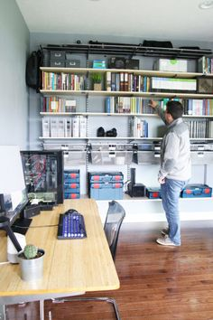 Home Organization- Organized and Masculine Home Office Reveal, man cave, office organization, The Container Store, Elfa, built in shelves, POANG, IKEA, standing desk, window trim, manly office, room makeover, room reveal, Elfa sand and platinum shelving, masculine office space