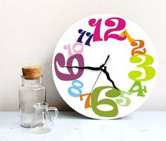 Christmas rainbow colorful Wall clock kitchen by ArtisEverything, $49.00