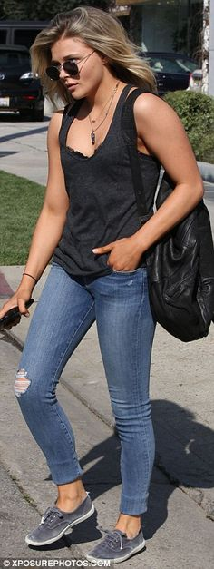 Casual cool: Chloe went casual with a slouchy grey tank top and distressed jeans for her appointment
