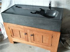 Concrete vanity sink molded from a Fender stratocaster.
