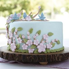 green cake with pink flowers