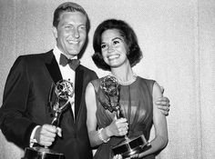 This May 25, 1964 file photo shows Dick Van Dyke, left, and Mary Tyler Moore, co-stars of 'The Dick Van Dyke Show' backstage at the Palladium with their Emmys for best actor and actress in a series at the Television Academy's 16th annual awards show, in Los Angeles. Moore died Wednesday, Jan. 25, 2017, at age 80. (AP Photo, File)