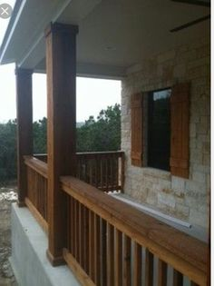 Marvelous Texas Hill Country stone home with cedar columns, porch railings, and cedar shutters by Kurk Homes The post Texas Hill Country stone home with cedar columns, porch railings, and cedar shut… appeared first on 99 Decor . Cedar Shutters, Remodel, House, Front Porch Stone, Porch Railing, House With Porch, Traditional Porch, Building A Porch, Stone Houses