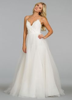 The stunning A-line spaghetti strap sweetheart neck white tulle floor-length wedding dress with the exquisite duchess lace and the sexy open back with the puff skirt