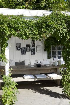 Lovely naturally shady place to eat in the garden. Like the black and white posters on the white wall too