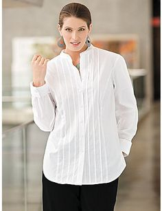 """One blouse every woman should own. Elongated crisp cotton shirt, with princess seams, front and back. Tuxedo pintucks, turn-back cuffs and mandarin collar. Relaxed fit. 95% cotton/5% spandex. Machine wash. Imported. Length: graded by size from 28"""" to 32"""". sonsi.com"""