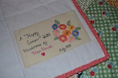 Quilt label - love the  perky flowers