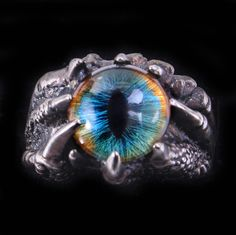 Renaissance style dragon eye dragon claw ring.  Piercing blue eye Gothic ring.  37.50 Use coupon code DESIGNSBLOOM for 10% off anything in my shop.  Follow link:https://www.etsy.com/shop/DesignsBloom #Gothic #Ring #Dragon #Claw