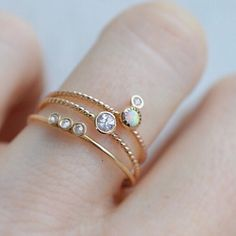 -solid 14kt gold twisted ring band -genuine opal -1.3mm diamond (VS/1 clarity) The most darling little stacking ring, perfect for everyday wear that will have you smitten! Available in all sizes (incl