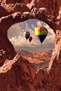 Hot air balloons drifting over Utah's Canyonlands National Park.