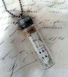 the bottle pendant  HOPE by theoldwhitehouse on Etsy, $25.00