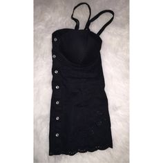 Guess Bustier Cure bustier by Guess. Snap button closure and corset tie at top back portion of bustier. It's stretchy on the back. Bra part is padded so you do not necessarily have to wear a bra with it. I took the tags off and never wore it. Guess Tops Tank Tops