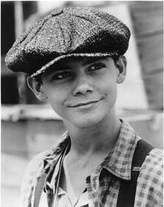 Spot Collins style. Newsies cap. Suspenders. collared shirt, unbuttoned.