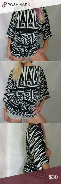 CHICO'S Black/White Tribal Flowy Boho Top 0 Excellent condition. May be a light mark on the inside of the collar from me putting it on (with makeup).  Lightweight fabric (100% polyester). Elastic gathering at the waist, 3/4 sleeve Size 0, which usually fits a small.  For reference, I'm 5'5 and normally wear a size 2-4. Chico's Tops Blouses