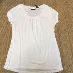 White cap sleeve tshirt from New York & company White cap sleeve tshirt from NY&co. Has small hole at the top of the back of the shirt shown in pic 4. Perfect for summer New York & Company Tops Tees - Short Sleeve