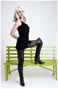 American singer Debbie Harry, of pop group Blondie, poses in a black mini-dress and thigh-length boots, June 1977.