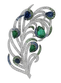 Elegant feather brooch by Gilan, set with 2.9cts sapphire, 2.58cts emerald, 0.46cts tsavorites and 2.66cts diamonds from the Journey to Dreams collection