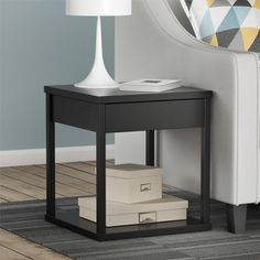 Redefine your living room with the sleek, minimalist lines of this attractive Altra Parsons End Table with Drawer. This End Table is designed with classic parsons styling that includes a simple silhouette with clean lines. The End Table features a small storage drawer that's perfect for remotes and coasters. This compact End Table is conveniently sized to fit in any room for a little extra storage. The Black finish looks right at home with dark bold colors or it can be paired with neutrals…