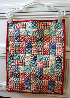 Mini patchwork quilt by Cara {Me? A Mom?}, via Flickr