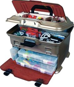 Flambeau® Multi-Loader T4 Pro Tackle Box  Flip-open top for fast access to storage compartments. Impact-resistant, see-through lid and front door. Offers two top-loading 4007 Tuff Tainer® boxes. T4P has four line dispensing ports, five Tuff Tainer boxes, one 1002 and two 3003 boxes.