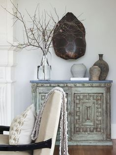 In Good Taste: Sam Allen - Design Chic - and amazing turtle shell over the chest in the living room - great paint color!