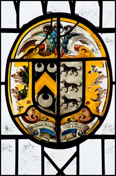 Heraldic glass in St Peter's Chruch at East Carlton, Northamptonshire, England