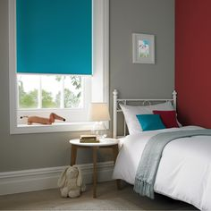 Banlight Duo FR blinds in Kingfisher from Style Studio. Colour pop. Roller blinds. Blinds for kids bedrooms. 2018 home interior trends. Home decor inspiration using intense colour. Neon jungle trend. Contemporary electric blue colour inspiration for decorating the home.