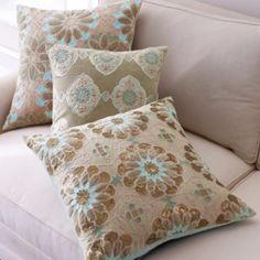 Embroidered blue and brown pillows from horchow.com