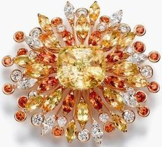 Gold, Yellow Beryl, Sapphire and a Diamond Brooch.