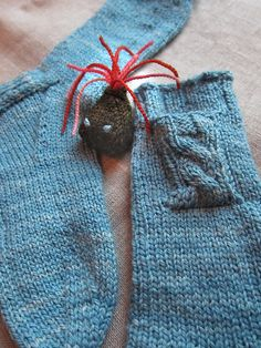hand knit socks with tiny pocket to keep your stuffed knit tiny-toy.  Quilt Otaku