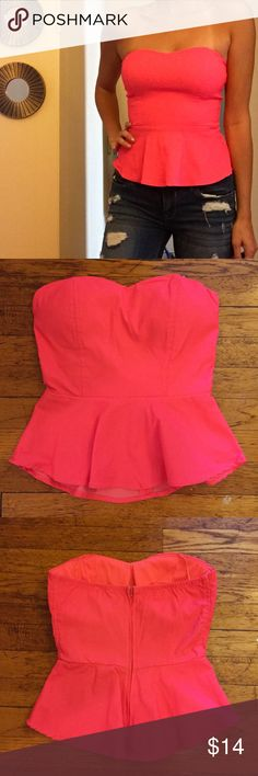 Coral Peplum Strapless Top Beautiful coral colored peplum strapless top. Never worn! Condition like new! Back has a zipper and clip at the top, front comes with fitted bra/padding shown in photos. Size is a medium. Material is 98% cotton, 2% spandex. Scratchy material, allows for the top to fit comfortably and look flattering! Tops