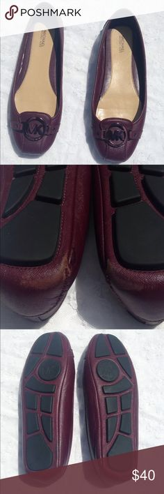 Michael Kors Fulton Moc Flats Cute Michael Kors leather upper slip-on flats in a burgundy red with matching color signature MK logo charm vamp, 1/4 heel, square toe and flexible rubber sole. Flats are in excellent used condition with scuffs at heel. See pic #2.  Scuff doesn't show while shoe are being worn. MICHAEL Michael Kors Shoes Flats & Loafers