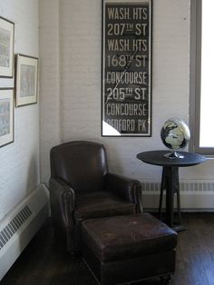 Leather chair.  Wall art.