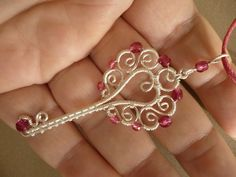 Pink key pendant wire wrapped